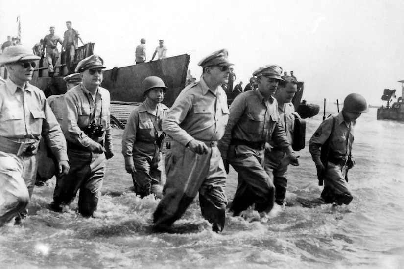 Troops wade ashore.