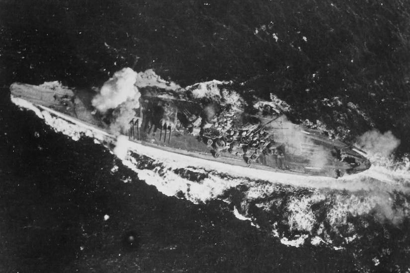 Smoke pours from battleship.