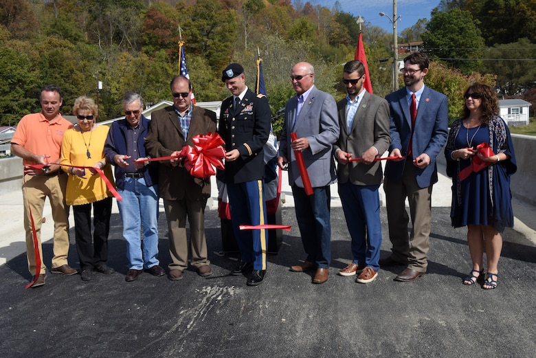Distinguished officials cut a ribbon Oct. 21, 2019 to officially dedicate Shepherd Street Bridge in Cumberland, Ky. The U.S. Army Corps of Engineers Nashville District and contractor Bush & Burchett, Inc., constructed the bridge as part of a flood risk reduction project on Looney Creek. (USACE photo by Lee Roberts)