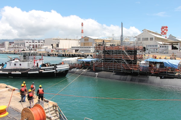 Shipyard workers carefully undock the USS Missouri (SSN-780) from Pearl Harbor Naval Shipyard & IMF's Dry Dock One on 4 September 2019. The undocking occurred just two weeks after Dry Dock One's celebrated centennial.