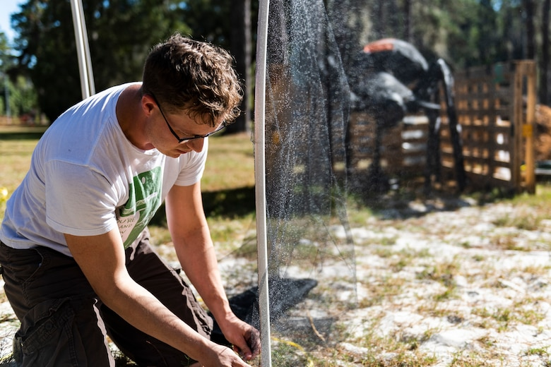 Staff Sgt. Cory Schollmeyer, 23d Civil Engineer Squadron pest management Airman, builds part of the 40th Moooody Haunted House Oct. 10, 2019, in Valdosta, Ga. On average, it takes nearly 1,000 volunteer hours to construct and run the haunted house. It costs nearly $5K for the materials and decorations, and requires a minimum of 24 volunteers per night to operate the haunted house. (U.S. Air Force photo by Airman 1st Class Hayden Legg)