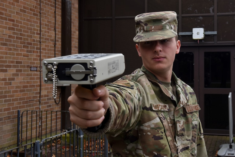 U.S. Air Force Senior Airman Enzo Guastavino, 48th Aerospace Medicine Squadron bioenvironmental technician, demonstrates how to use an ADM-300 radiation detection device at Royal Air Force Lakenheath, England, Oct. 4, 2019. The ADM-300 can be used in all environments to detect Gamma and Beta radiation (U.S. Air Force photo by Airman 1st Class Rhonda Smith)