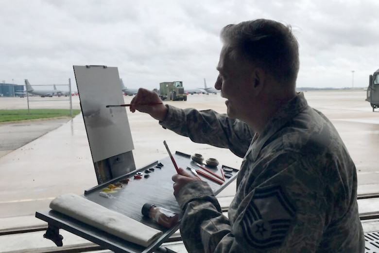 Senior Master Sgt. Darby Perrin, Air Force Reserve Command heritage and combat artist, creates a color sketch of a C17 Globemaster at Grissom Air Reserve Base, Indiana April 18, 2019. The sketch will be used to create a larger studio painting. (U.S. Air Force photo/Lt. Col. Warren Neary)
