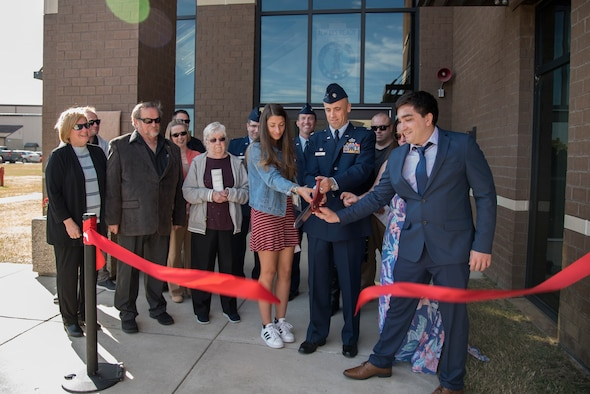 Family and friends of Capt. Robert M. Mendez cut a ribbon during the 108th Civil Engineer Squadron building's dedication ceremony at Joint Base McGuire-Dix-Lakehurst, N.J., Oct. 19, 2019. The building was dedicated to Mendez who passed away in January 2017 after being diagnosed with kidney cancer in late 2018. Mendez was the deputy base civil engineer for the 108th CES. (U.S. Air National Guard photo by Senior Airman Julia Santiago)