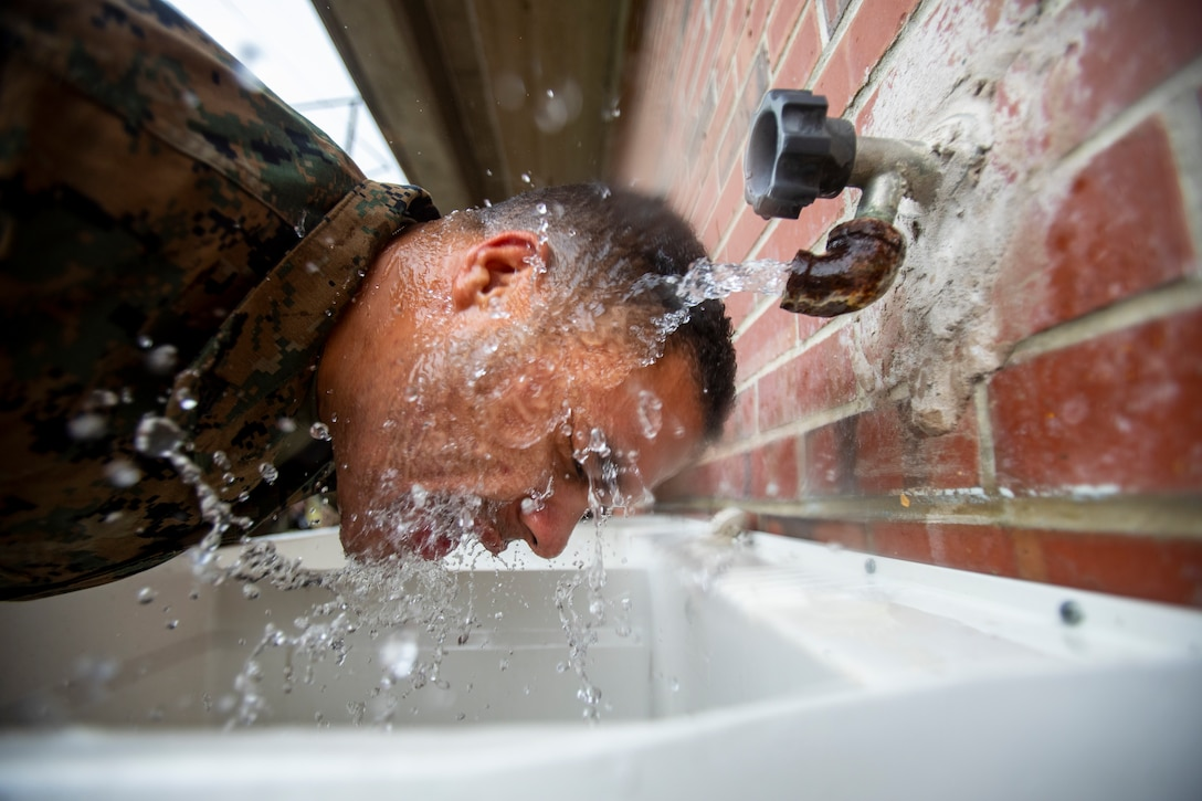 A Marine attached to Deployment Processing Command Reserve Support Unit-East, Force Headquarters Group, runs water of his face after gas chamber training at Marine Corps Base Camp Lejeune, North Carolina, Oct. 22, 2019. The DPC/RSU-East staff provide activated Reserve units/dets various types of training such as gas chamber qualification. During the qualification, Marines are taught chemical, biological, radiological and nuclear threats, reactions to CBRN attacks, and how to take proper care and use of a gas mask.
