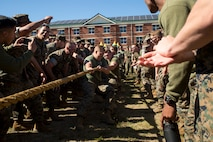 U.S. Marines with Marine Corps Security Force Regiment (MCSFR) participate in tug-of-war competition during a field meet October 18, 2019 at Naval Weapons Station Yorktown, Virginia.