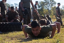 U.S. Marines with Marine Corps Security Force Regiment (MCSFR) prepare to do squad push-ups during a field meet October 18, 2019 at Naval Weapons Station Yorktown, Virginia.