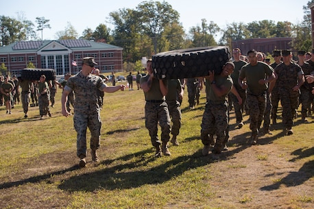 U.S. Marines with Marine Corps Security Force Regiment (MCSFR) race while carrying a tire during a field meet October 18, 2019 at Naval Weapons Station Yorktown, Virginia.