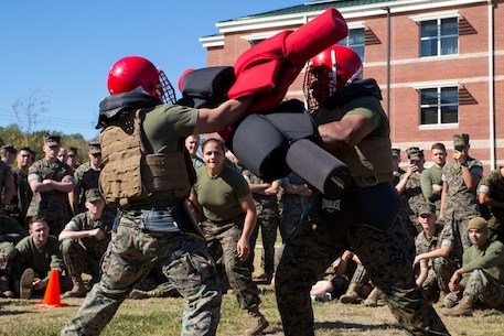 U.S. Marines with Marine Corps Security Force Regiment (MCSFR) participate in a pugil stick bout during a field meet October 18, 2019 at Naval Weapons Station Yorktown, Virginia.