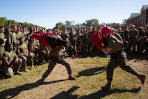 U.S. Marines with Marine Corps Security Force Regiment (MCSFR) battle with pugil sticks during a field meet October 18, 2019 at Naval Weapons Station Yorktown, Virginia.