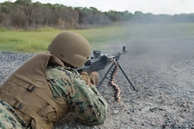 U.S. Marine Corps Master Sgt. Patrick H. Hammer, a student in the Marine Advisor Course, fires a PKM machine gun during foreign weapons training in Moyock, North Carolina, Sept. 17, 2019.