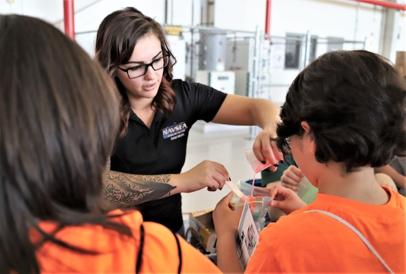 IMAGE: VIRGINIA BEACH, Va. (Sept. 20, 2019) – Lauren Sencio, Naval Surface Warfare Center Dahlgren Division (NSWCDD) engineer, helps a student bag her slime. She was among 30 scientists and engineers from Naval Surface Warfare Center Dahlgren Division (NSWCDD) Dam Neck Activity and NSWCDD who educated students through hands-on displays at Naval Air Stations Oceana's fourth annual Science, Technology, Engineering and Mathematics Lab. (U.S. Navy photo by George Bieber/Released)