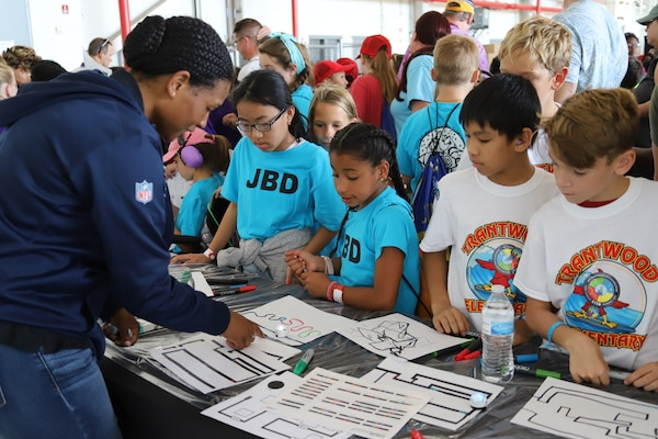 IMAGE: VIRGINIA BEACH, Va. (Sept. 20, 2019) – Lace Bacchus, Naval Surface Warfare Center Dahlgren Division (NSWCDD) cyber security engineer, demonstrates how Ozobots follow hand-drawn paths. She was among 30 scientists and engineers from Naval Surface Warfare Center Dahlgren Division (NSWCDD) Dam Neck Activity and NSWCDD who educated students through hands-on displays at Naval Air Stations Oceana's fourth annual Science, Technology, Engineering and Mathematics Lab. (U.S. Navy photo by George Bieber/Released)