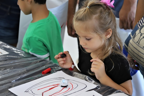 IMAGE: VIRGINIA BEACH, Va. (Sept. 20, 2019) – One of 7,000 fifth-graders from Chesapeake and Virginia Beach elementary schools watches an Ozobot follow her hand-drawn path at Naval Air Station Oceana's fourth annual Science, Technology, Engineering and Mathematics (STEM) Lab. The event broke the Guinness World Record for the largest field trip on record. More than 30 scientists and engineers from Naval Surface Warfare Center Dahlgren Division (NSWCDD) Dam Neck Activity and NSWCDD volunteered their time and talents to educate the students through hands-on STEM displays. (U.S. Navy photo by George Bieber/Released)