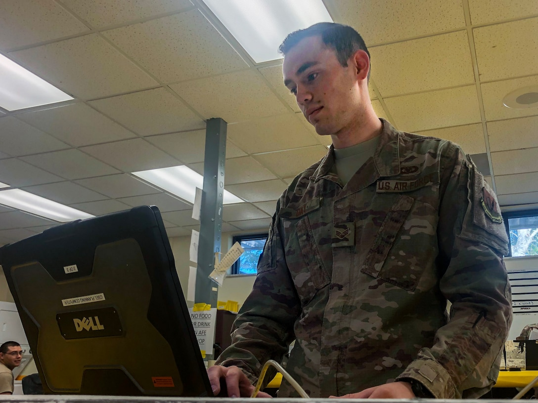 U.S. Air Force Senior Airman Matthew Day, 20th Operations Support Squadron aircrew flight equip journeyman works on a shop computer at Shaw Air Force Base, South Carolina, Oct. 10, 2019.