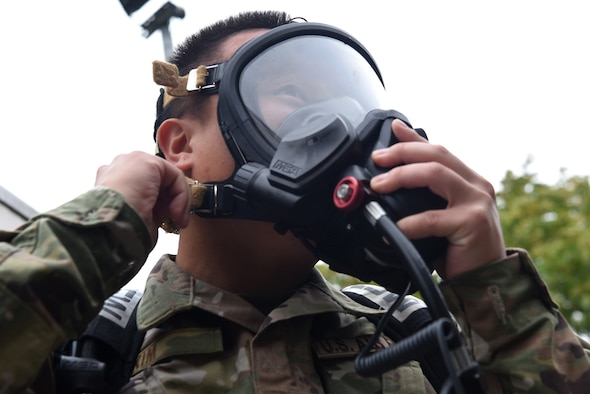 Senior Airman Tyler Kim, bioenvironmental technician assigned to the 48th Aerospace Medicine Squadron, recently demonstrated how to gear up at Royal Air Force Lakenheath, England. A Self-Contained Breathing Apparatus is used to provide breathable air in emergency situations that are dangerous to life or the health atmosphere. (U.S. Air Force photo by Airman 1st Class Rhonda Smith)