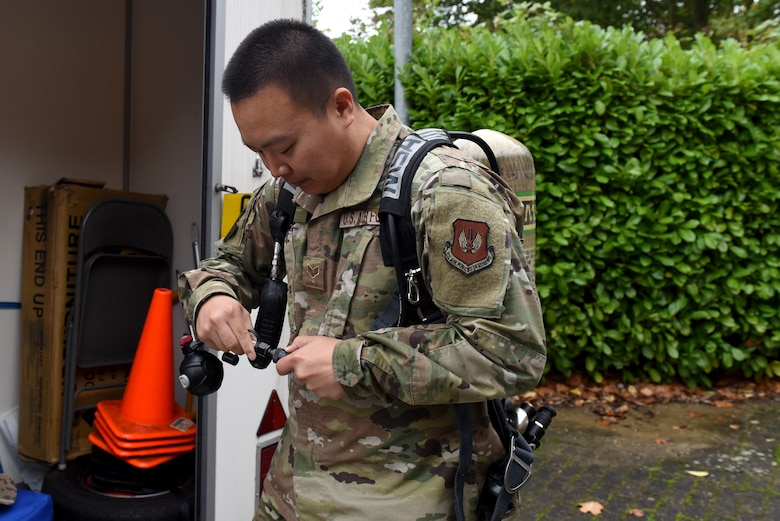 Senior Airman Tyler Kim; bioenvironmental technician assigned to the 48th Aerospace Medicine Squadron; recently demonstrated how to gear up at Royal Air Force Lakenheath; England. A Self-Contained Breathing Apparatus is used to provide breathable air in emergency situations that are dangerous to life or the health atmosphere. (U.S. Air Force photo by Airman 1st Class Rhonda Smith)