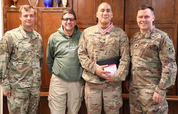 Army Maj. Mark Lojewski (2nd from right) wears his newly presented Bronze de Fleury Medal. Lojewski received the medal from Army Lt. Col. Dan Hayden, USACE Afghanistan District deputy commander (right) during a ceremony on Bagram Airfield, Afghanistan, on Oct. 22, 2019. Also pictured are Afghanistan District Senior Enlisted Advisor Sergeant Maj. Anthony Powers (left) and Lojewski's supervisor James Root, who nominated Lojewski for the award. The de Fleury Medal is one of the highest awards a member of the U.S. Army Corps of Engineers can receive and is presented to only a few Soldiers every year.