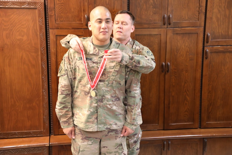 Afghanistan District Deputy Commander Army Lt. Col. Dan Hayden presents the Bronze de Fleury Medal to Maj. Mark Lojewski during a ceremony at Bagram Airfield, Afghanistan, on Oct. 22, 2019. The de Fleury Medal is one of the highest awards a member of the U.S. Army Corps of Engineers (USACE) can receive and is presented to only a few Soldiers every year. The Bronze de Fleury Medal may be presented to an individual who has rendered significant service or support to an element of the Engineer Regiment.