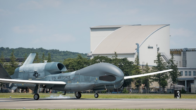 An RQ-4 Global Hawk, assigned to the 319th Operations Group, Detachment 1, Andersen Air Force Base, Guam, lands at Yokota Air Base, Japan, Aug. 5, 2019, for a rotational deployment. The movement maintains operations for Global Hawks during months of inclement weather endured at Andersen AFB, such as typhoons and other scenarios which have the potential to hinder readiness. (U.S. Air Force photo by Senior Airman Juan Torres)
