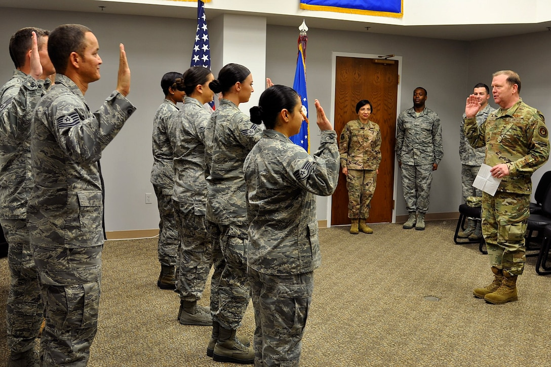Lt. Gen. Richard W. Scobee, Commander, Air Force Reserve Command, administers the Oath of Enlistment to Airmen attached to the 940th Airlift Wing, Beale Air Force Base, California, for a re-enlistment ceremony during the January Unit Training Assembly of 2019, Beale Air Force Base, California. (Courtesy photo)