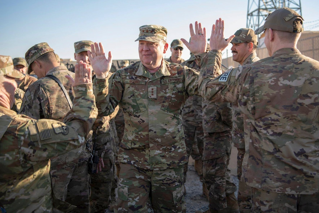 Lt. Gen. Richard W. Scobee, Commander, Air Force Reserve Command, high-fives members of the 386th Expeditionary Civil Engineer Squadron during a visit to an undisclosed location in Southwest Asia, Feb. 12, 2019. (U.S. Air Force Photo by Tech. Sgt. Robert Cloys)
