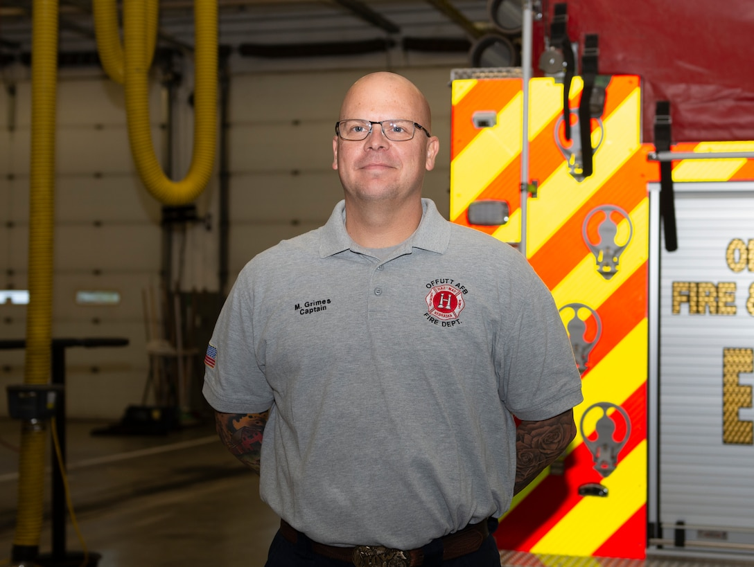 Capt. Matthew Grimes, Offutt Air Force Base Fire Department fireman, poses behind Offutt Fire & Rescue Engine 11 currently housed at Bellevue Fire District 4 in Bellevue, Nebraska. Grimes is a member of Offutt's Fire Station 2 and is living and working alongside Bellevue Fire Department firefighters while Offutt AFB Fire Station 2 is undergoing renovations. The project is scheduled to be completed in March 2020.