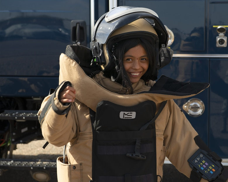 Trinity Garcia, a member of the Childhelp program, wears an Explosive Ordnance Disposal 9 bomb suit during the Childhelp Kids Day of Hope tour Oct. 16, 2019, at Luke Air Force Base, Ariz.