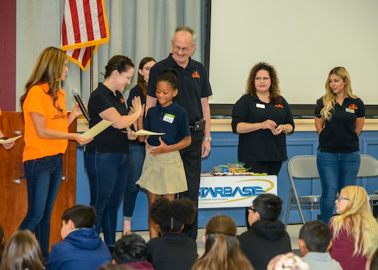 Caitlin Craig, STARBASE Edwards instructor, congratulates Cierra Gibson, a fifth grade STARBASE Edwards graduate and Student Council Vice-President, during the STARBASE graduation ceremony at the Idea Academy at Cottonwood Elementary School in Palmdale, California, Oct. 23. (U.S. Air Force photo by Giancarlo Casem)
