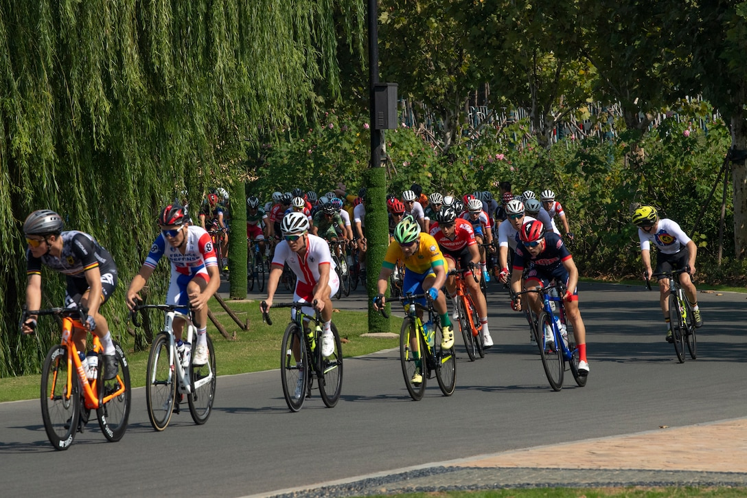 Bicyclists turn a corner during an 80-mile race.