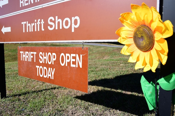 A sign hangs from a directional sign on Dobbins Air Reserve Base, Ga. showing that the base thrift shop is open. The shop is open Thursdays and drill weekend Saturdays from 10 a.m. to 3 p.m. (U.S. Air Force photo/Tech. Sgt. Andrew Park)