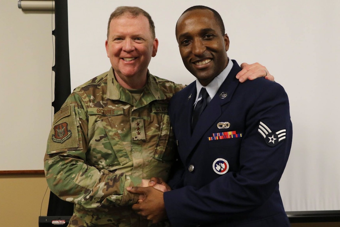Lt. Gen. Richard W. Scobee, Commander, Air Force Reserve Command, shakes hands with a Senior Airman attached to the 452d Air Mobility Wing, March Air Reserve Base, California, during a visit to the base in April of 2019. (U.S. Air Force photo by 1st Lt. Russell McMillan)