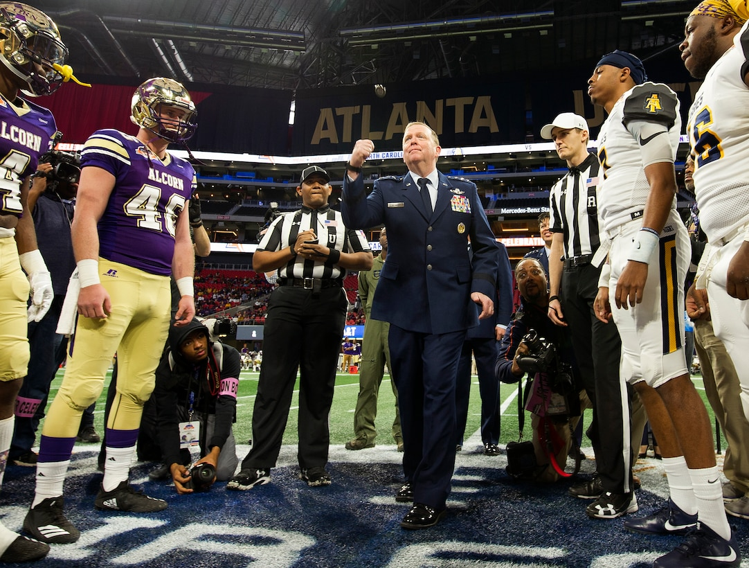 Lt. Gen. Richard W. Scobee, Commander, Air Force Reserve Command, tosses the game coin in the air at midfield of the Mercedes-Benz Stadium in Atlanta, Georgia, before the start of the Air Force Reserve Celebration Bowl, December 15, 2018. (U.S. Air Force photo by Master Sgt. Stephen D. Schester)