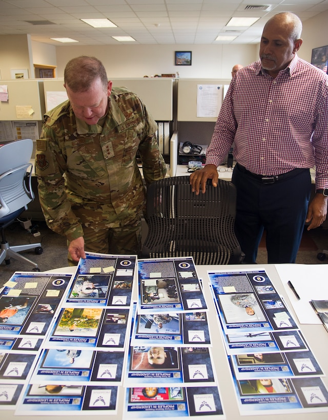 Lt. Gen. Richard W. Scobee, Commander, Air Force Reserve Command, looks over the Profiles in Leadership printouts with Phil Rhodes, a public affairs specialist, during a tour of the AFRC PA facilities, Robins Air Force Base, Ga., November 8, 2018. (U.S. Air Force photo by Master Sgt. Stephen D. Schester)