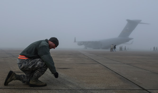 Staff Sgt. David Barbieri, 911th Aircraft Maintenance Squadron crew chief, picks up a piece of foreign object debris during a FOD walk at Pittsburgh International Airport Air Reserve Station, Pennsylvania, Oct. 29, 2019.