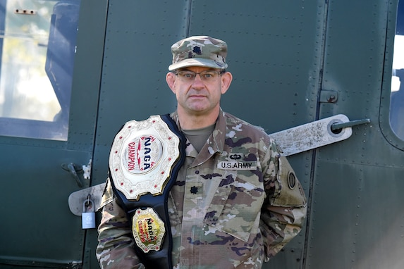 Lt. Col. Pete Caragher, Deputy G-3, 85th U.S. Army Support Command, pauses for a photo with his first place belt in the expert category from the 2012 New England Championships in Springfield, Massachusetts.