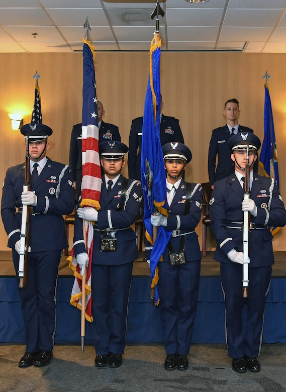 The base honor guard presents the colors during the Detachment 1, 548th Intelligence, Surveillance and Reconnaissance Group change of command ceremony at Davis-Monthan Air Force Base, Arizona, Oct. 18, 2019. During the ceremony, Maj. Kevin Lukowiak relinquished command to Capt. Chance Smith. (U.S. Air Force photo by Airman 1st Class Michael Richmond)