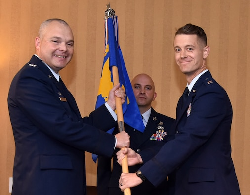 Capt. Chance Smith (right) accepts command of Detachment 1, 548th Intelligence, Surveillance and Reconnaissance Group from Col. Andrew Souza, 548th ISRG commander, during a change of command ceremony at Davis-Monthan Air Force Base, Arizona, Oct. 18, 2019. Detachment 1 was established nine years ago and contains 17 Airmen. (U.S. Air Force photo by Airman 1st Class Michael Richmond)