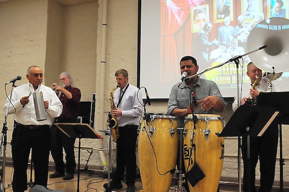 Five-member band plays music and sings.