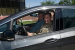 The Adjutant General of Colorado U.S. Air Force Maj. Gen. Mike Loh and retired Department of Military and Veteran Affairs Deputy Executive Director Mickey Hunt test the DMVA's new all-electric Chevy Bolts July 31, 2019, at the Joint Force Headquarters - Colorado complex in Centennial, Colorado. The transition from gas to electric vehicles is part of the State of Colorado's effort to achieve sustainability and greener government. (U.S. Air National Guard photo by Tech. Sgt. Chance Johnson)