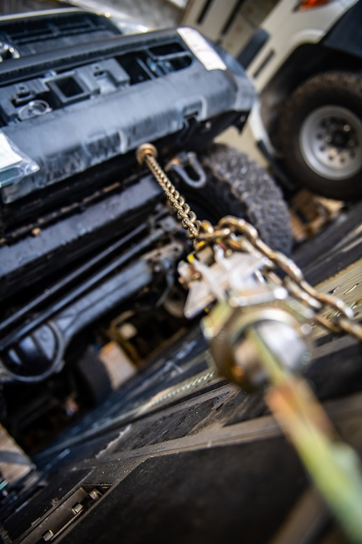 Chains used to secure cargo inside a U.S. Air Force C-17 Globemaster III during flight are disconnected prior to unloading in Jordan, Oct. 14, 2019. The port provides aerial logistics for the American Embassy to Jordan through the Military Assistance Program, handling cargo and passenger movement in support of State Department efforts.
