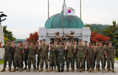 U.S. Marines with U.S. Marine Corps Forces, Korea pose for a photo with the Commandant of the Republic of Korea Marine Corps, Lt. Gen. Lee, Seung-do before a field meet hosted by the ROK Marine Corps, October 23. The Marines competed in multiple games and competitions including soccer, dodge ball, a three legged race, and a 1200 meter relay race. The field meet enhanced the ROK-U.S. Alliance and strengthened the relationship between the two countries' Marine Forces. (Official U.S. Marine Corps photos by Sgt. Parker Golz)