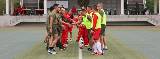 BARAN, Republic of Korea – U.S. and Republic of Korea Marines shake hands after a soccer match here, October 23. The Marines competed in multiple games and competitions including soccer, dodge ball, a three legged race, and a 1200 meter relay race. The field meet enhanced the ROK-U.S. Alliance and strengthened the relationship between the two countries' Marine Forces. (Official U.S. Marine Corps photos by Sgt. Parker Golz)