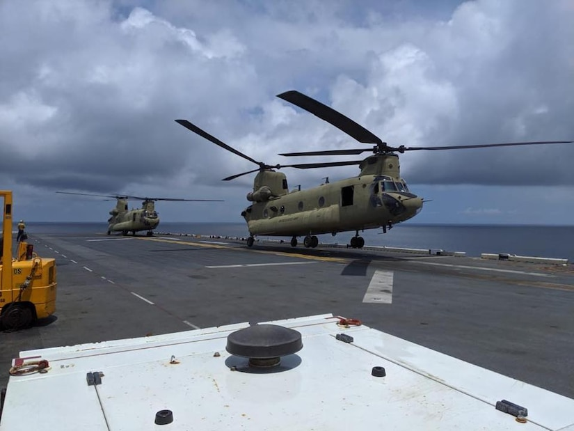 Army CH-47 Chinook lands on the deck of the USS Wasp