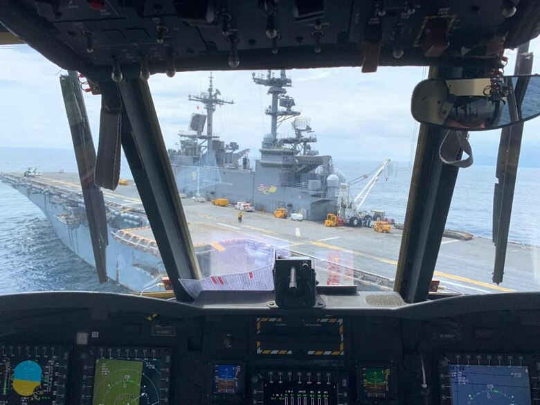 the view of the landing deck of the USS Wasp from the cockpit of a CH-47 Chinook.