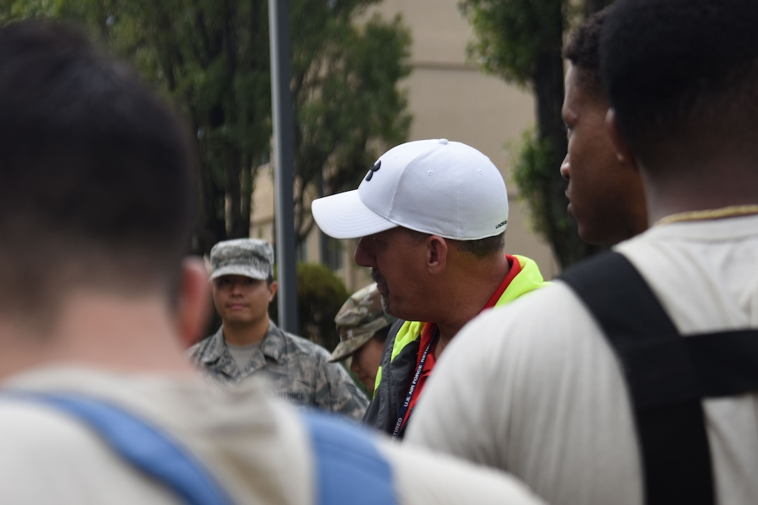 Dan Janssen, Precision Planning and Simulation Inc. instructor, gives feedback to participants in the fuel spill exercise at Osan Air Base, Republic of Korea, October 18, 2019. Janssen travels to over a hundred bases across the globe to administer training exercises like this one to make sure military installations are prepared for the worst case scenario. (U.S. Air Force photo by Staff Sgt. Benjamin Bugenig)