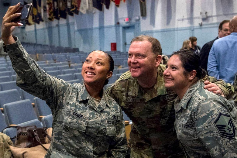 Lt. Gen. Richard W. Scobee, Commander, Air Force Reserve Command, posses for a selfie with Airmen during a visit to the 514th Air Mobility Wing on Joint Base McGuire-Dix-Lakehurst, N.J., January 12, 2018. Scobee visited the 514 AMW to become more familiar with the units capabilities and the Reserve Citizen Airmen that serve within them. (U.S. Air Force photo by Staff Sgt. Sean M. Evans)
