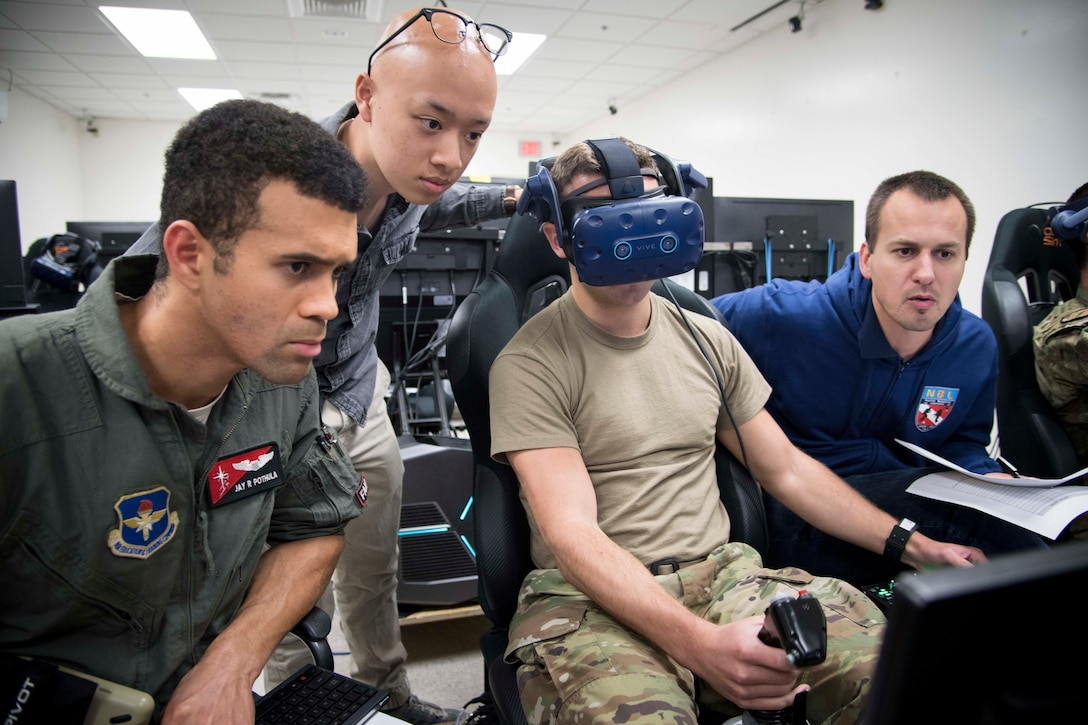 U.S. Air Force Capt. Jay Pothula, Pilot Training Next instructor pilot, and NASA officials observe a future student of PTN version three during a virtual reality flight at Joint Base San Antonio-Randolph, Texas, Oct. 22, 2019, as part of a collaborative research agreement between PTN and NASA. The partnership will focus on biometric data collection and the application of emerging technology into PTN curriculum that will innovate the student pilot learning environment. (U.S. Air Force photo by Sean M. Worrell)