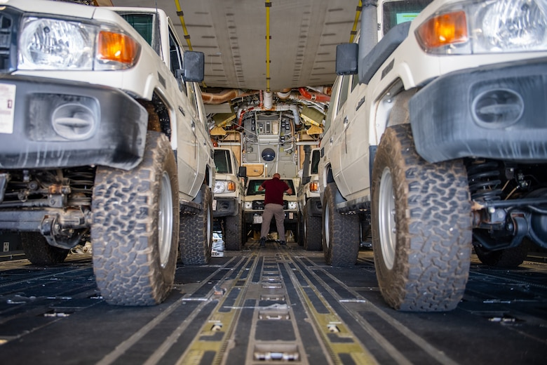 Tech. Sgt. Kyle Hersel, Assistant NCO-in-charge of Air Terminal Operations, Jordan Port, 387th Air Expeditionary Squadron, confirms the cargo manifest for a delivery of vehicles in Jordan, Oct. 14, 2019. The port provides aerial logistics for the American Embassy to Jordan through the Military Assistance Program, handling cargo and passenger movement in support of State Department efforts.