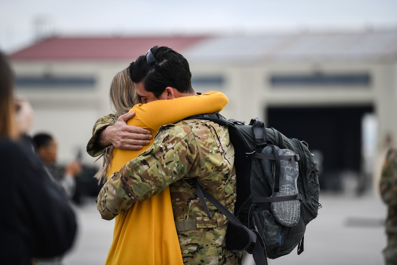 A U.S. Airman reunites with his family at Aviano Air Base, Italy, Oct. 8, 2019.The HH-60G is also tasked to perform military operations other than war, including civil search and rescue, medical evacuation, disaster response, humanitarian assistance, security cooperation/aviation advisory, NASA space flight support, and rescue command and control. (U.S. Air Force photo by Airman 1st Class Ericka A. Woolever
